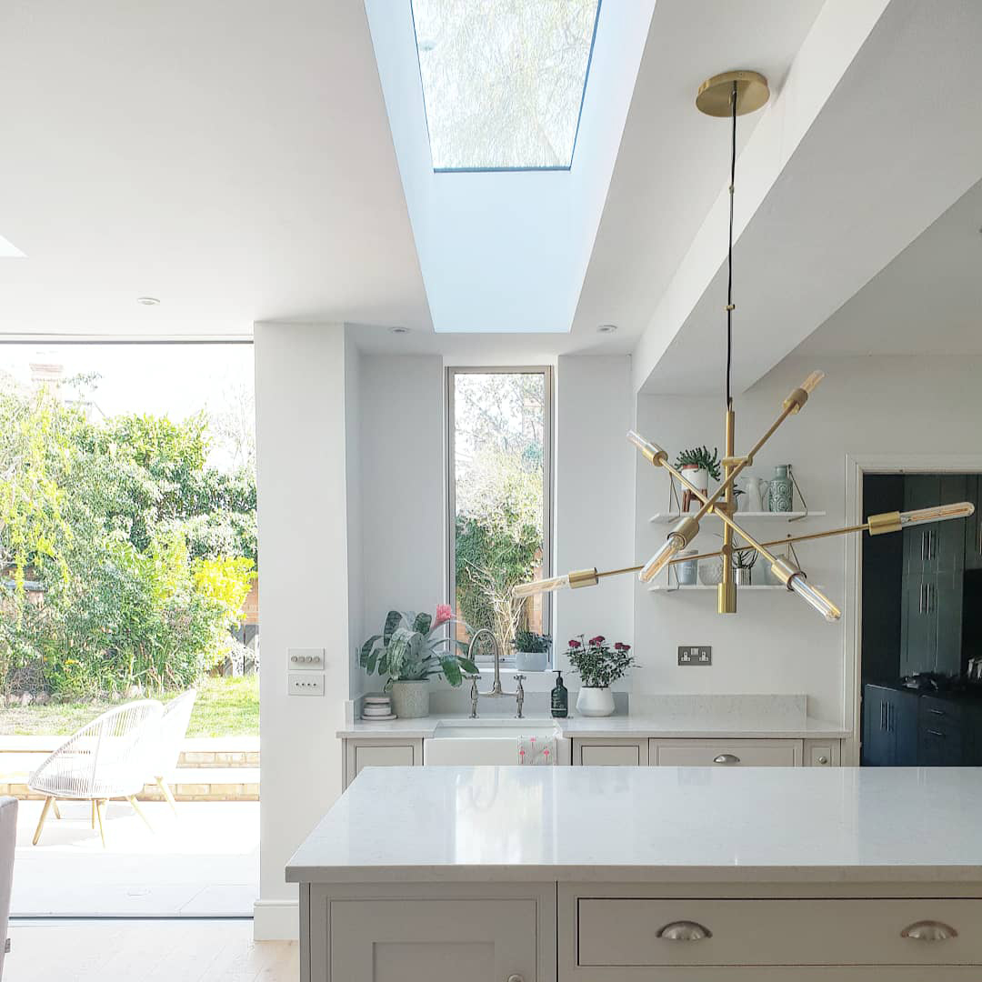 A long slim rooflight lines up perfectly with the kitchen window to create a bold contemporary finish while flooding our clients home with light.