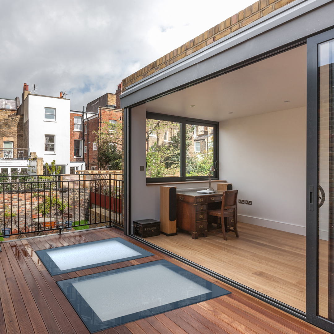 Dual walk-on rooflights on a terrace  in North London help bring light into the room below