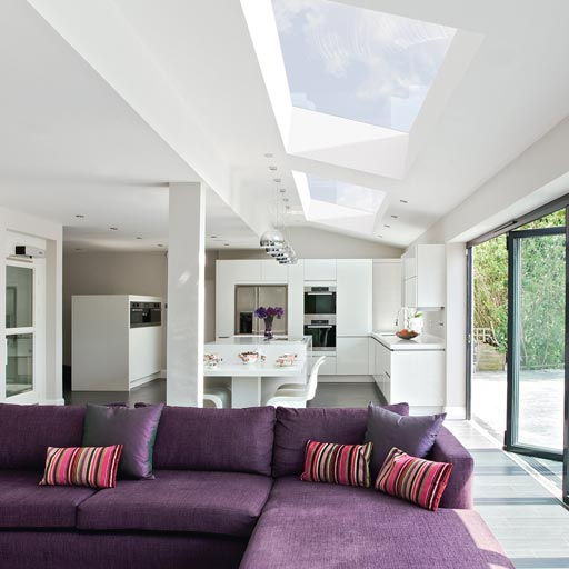 white kitchen with two pitched rooflights